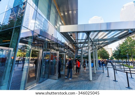 NEW YORK CITY - OCTOBER 06, 2015: National September 11 Memorial Museum with unidentified people. It commemorates the September 11, 2001, attacks, and the World Trade Center bombing of 1993 - stock photo