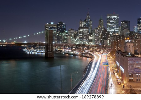 NEW YORK CITY - OCTOBER 27: Night scene of the Brooklyn bridge, FDR and Manhattan skyline, New York City on October 27th, 2013 in New York City, USA - stock photo