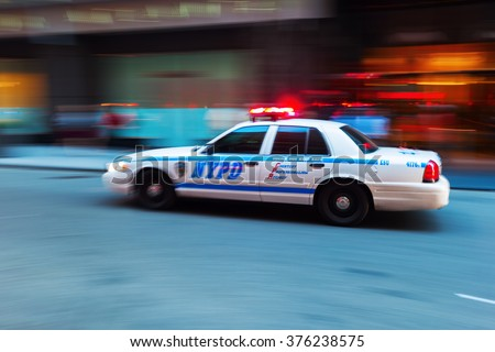 NEW YORK CITY - OCTOBER 07, 2015: Police car of the NYPD in Manhattan, NYC, in motion blur. NYPD is one of the oldest police departments established in US, tracing its roots back to the 17th century. - stock photo