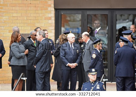NEW YORK CITY - OCTOBER 27 2015: Police officers, families of police and elected officials attended a viewing for slain NYPD officer Randolph Holder in Jamaica, Queens.  NYPD commissioner Bratton - stock photo