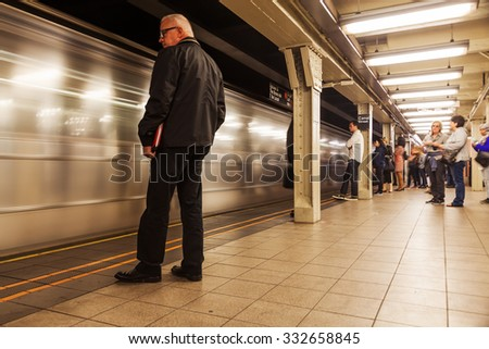 NEW YORK CITY - OCTOBER 14, 2015: subway station in Manhattan with unidentified people. The New York City Subway is the worlds largest rapid transit system by length of routes and number of stations  - stock photo