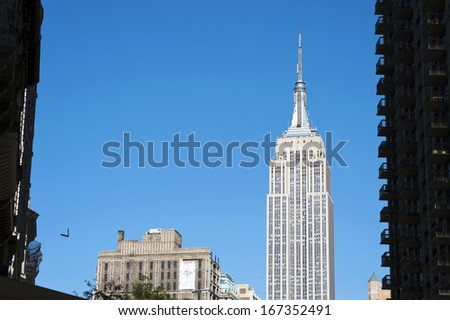 NEW YORK CITY - OCTOBER 28: The Empire State Building shines in the afternoon on October 28th, 2013 in New York, USA. The Empire State Building is a 102-story landmark and American icon in New York. - stock photo