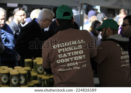 NEW YORK CITY - OCTOBER 19 2014: the Lower East Side's Orchard Street Pickle Day fair brought dozens of food & snack vendors into contact with hundreds of passersby
