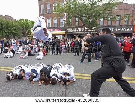 NEW YORK CITY - OCTOBER 1 2016: The 50th Annual Ragamuffin Parade filled Third Avenue in Bay Ridge with kids of all ages wearing bright costumes as they have since 1966. Tae Kwan Do demonstration