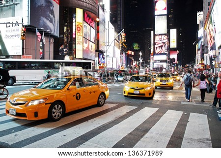 NEW YORK CITY - OCTOBER  15: Times Square at night on October  15, 2012 in New York, it is the major commercial intersection in New york and one of the most visited tourist attractions in the world. - stock photo