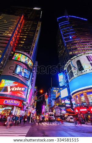NEW YORK CITY - OCTOBER 10, 2015: Times Square at night with unidentified people. It is one of the worlds busiest pedestrian intersections and a major center of worlds entertainment industry - stock photo