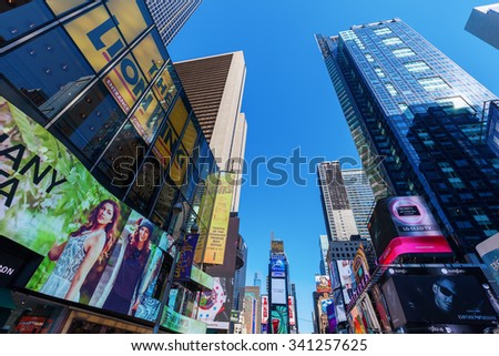 NEW YORK CITY - OCTOBER 10, 2015: Times Square in Manhattan, NYC. It is one of the worlds busiest pedestrian intersections and a major center of worlds entertainment industry - stock photo