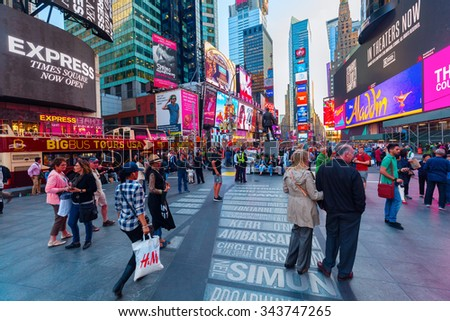 NEW YORK CITY - OCTOBER 13, 2015: Times Square with unidentified people. It is one of the worlds busiest pedestrian intersections and a major center of worlds entertainment industry
