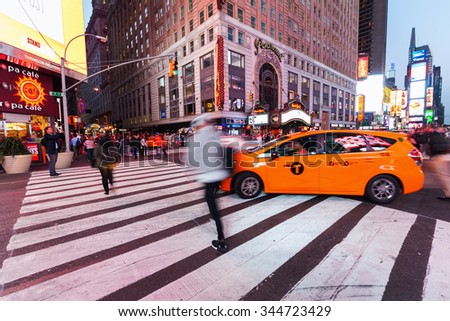 NEW YORK CITY - OCTOBER 09, 2015: Times Square with unidentified people. It is one of the worlds busiest pedestrian intersections and a major center of worlds entertainment industry - stock photo