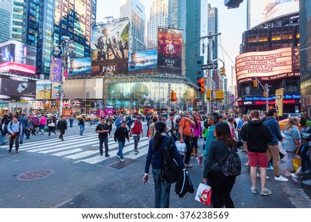NEW YORK CITY - OCTOBER 07, 2015: Times Square with unidentified people. It is one of the worlds busiest pedestrian intersections and a major center of worlds entertainment industry - stock photo