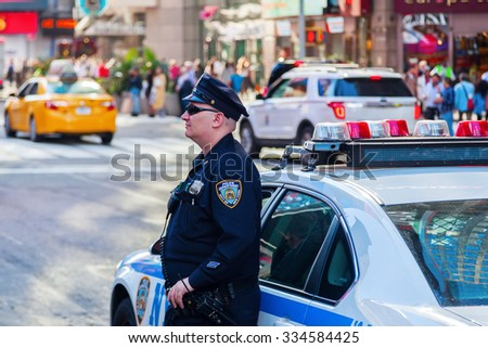 NEW YORK CITY - OCTOBER 06, 2015: unidentified police officer at Times Square, NYC. The NYPD was established in 1845 and is the largest municipal police force in the US and one of the oldest - stock photo