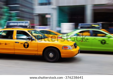 NEW YORK CITY - OCTOBER 07, 2015: yellow and green cab in Manhattan. The traditional taxi color in NYC is yellow. The green ones also called Boro Cabs are allowed to pick up people in outer boroughs. - stock photo