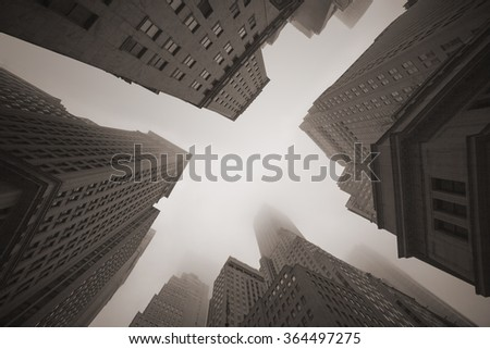 New York City old-fashioned skyscrapers in foggy sky  - stock photo