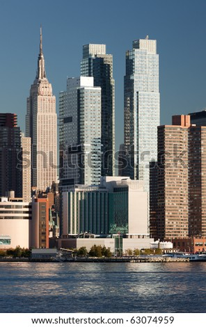 New York City panorama with Manhattan Skyline's over Hudson River - stock photo