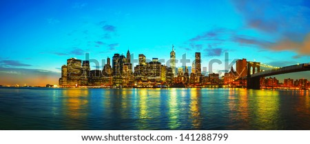New York City panoramic cityscape in the evening at sunset - stock photo