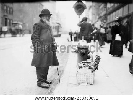 New York City, Pretzel vendor, 6th Avenue, New York, photograph circa 1900s-1920s - stock photo