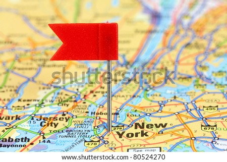 New York City. Red flag pin on an old map showing travel destination. - stock photo