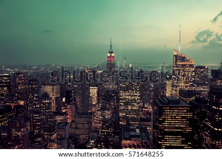 New York City rooftop view with urban architectures at sunset