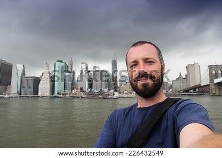 New York City selfie photo by a young adult male. Bearded man portrait. - stock photo