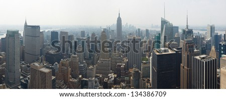 NEW YORK CITY - SEP 4: Empire State Building and crowded skyscrapers on September 4, 2011 in New York City. With a population of 8.2 million, New York City is the most populous city in the USA. - stock photo