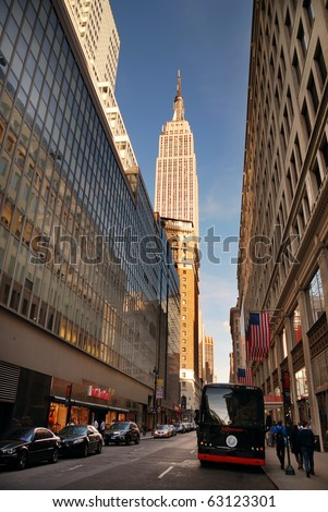 NEW YORK CITY - SEP 11: Fifth Avenue, as a symbol of wealthy New York and one of the most expensive streets in the world, with Empire State Building, September 11, 2010 in Manhattan, New York City. - stock photo