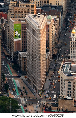 NEW YORK CITY - SEP 11: Flat Iron building, considered to be one of the first skyscrapers ever built, with New York City street aerial view. September 11, 2010 in Manhattan, New York City. - stock photo