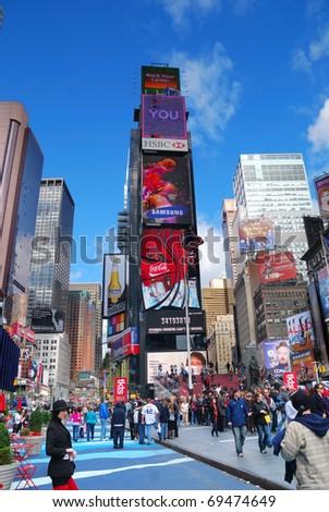 NEW YORK CITY - SEP 5: Times Square, featured with Broadway Theaters and LED signs, is a symbol of New York City and the United States, September 5, 2009 in Manhattan, New York City. - stock photo