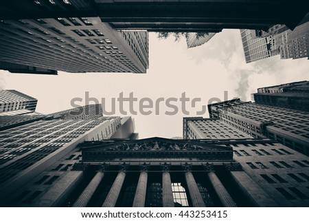 NEW YORK CITY - SEP 5: Wall Street with skyscrapers on September 5, 2014 in Manhattan, New York City. Wall Street financial district has been called the world's principal financial center. - stock photo