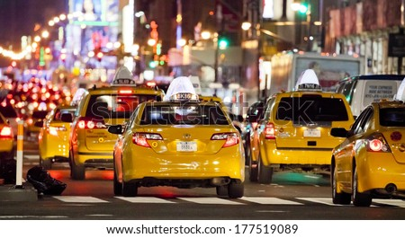 NEW YORK CITY - SEPT 22: Eight Avenue, featured with Taxi Cabs, Shops and animated LED signs, is a symbol of New York City and the United States, September 22, 2012 in Manhattan, New York City - stock photo