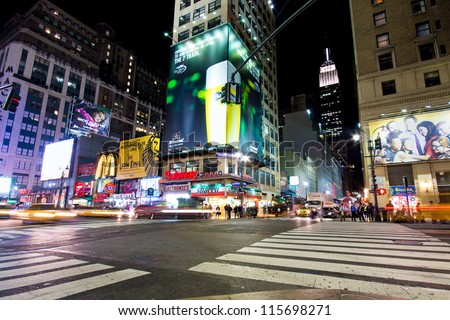 NEW YORK CITY - SEPT 13: Intersection in Midtown Manhattan seen on the night of Sept. 13, 2012.  As NYC's  largest business district, Midtown is the busiest single commercial district in the USA. - stock photo
