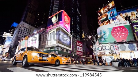 NEW YORK CITY - SEPT 25: Times Square, featured with Broadway Theaters, Taxi Cabs and animated LED signs, is a symbol of New York City and the United States, September 25, 2012 in Manhattan, New York. - stock photo