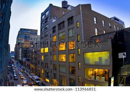 NEW YORK CITY - SEPT 19:  View of Chelsea art galleries in NYC on the night of Sept. 13, 2012.  This historic district has become a center for art with hundreds of art galleries and studios. - stock photo