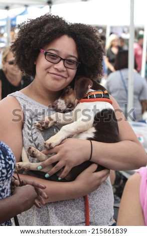 NEW YORK CITY - SEPTEMBER 7 2014: Adoptapalooza, sponsored by the NYC Mayor's Alliance for Animals, brought some two dozen rescue organizations to Union Square Park to showcase animals in need - stock photo