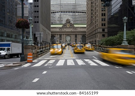 NEW YORK CITY - SEPTEMBER 17:Crown Victoria Taxis, which may be phased out for hybrids, rushing in and out  at Grand Central Station, September 17, 2010 in New York. - stock photo