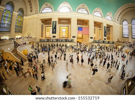 NEW YORK CITY - SEPTEMBER 22: Famous New York City landmark Grand Central Station (has more than 44 tracks and 67 platforms) full of tourists and commuters on September 22, 2013 in New York, NY - stock photo
