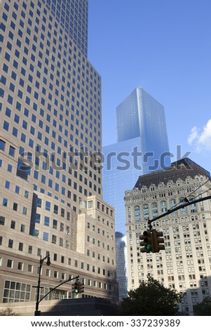New York City, 11 september 2015: green traffic lights and high rise buildings in lower manhattan new york - stock photo