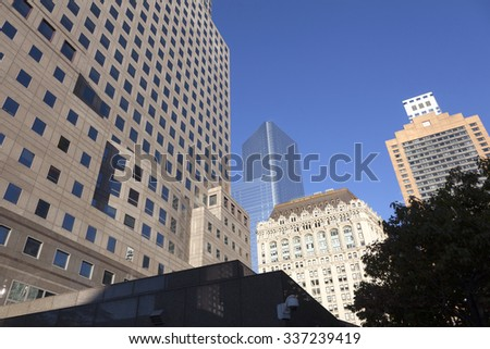 New York City, 11 september 2015: high rise buildings in lower manhattan new york and tree - stock photo