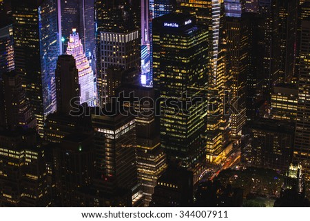 New York City - September 26: Manhattan night view from the Empire State Building Times Square buildings on 26 September 2015. - stock photo