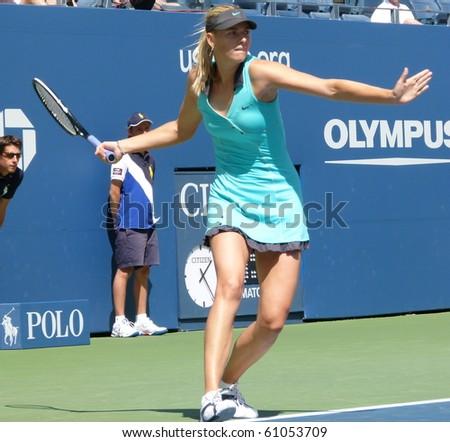NEW YORK CITY - SEPTEMBER 4:- Maria Sharapova gets ready to return the ball at Arthur Ashe stadium during the US Open on September 4, 2010 in New York City. - stock photo