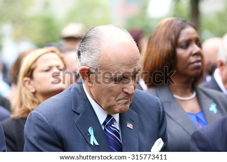 NEW YORK CITY - SEPTEMBER 11 2015: Memorial services were held at Ground Zero to mark the 14th anniversary of the World Trade Center attacks. Former NYC mayor Rudy Giuliani - stock photo