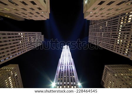 NEW YORK CITY - SEPTEMBER 18 : New York landmark Rockefeller Center night view. The historic art deco GE building is an attraction for uncountable visitors. September 18, 2014, in New York City, USA  - stock photo