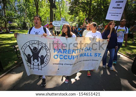 NEW YORK CITY - SEPTEMBER 17 2013: Occupy Wall Street  marked its second anniversary with a rally at Zuccotti Park & march to Washington Square Park on September 17 2013 in New York City