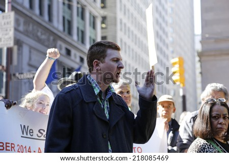NEW YORK CITY - SEPTEMBER 17 2014: Occupy Wall Street marked the third anniversary of its founding as several dozen activists gathered in Zuccotti Park. Radical journalist & OWS organizer Caleb Maupin - stock photo
