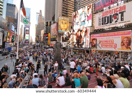 NEW YORK CITY - SEPTEMBER 4: Pedestrian malls full of crowds on a summer Saturday afternoon in Times Square September 4, 2010 in New York City. - stock photo