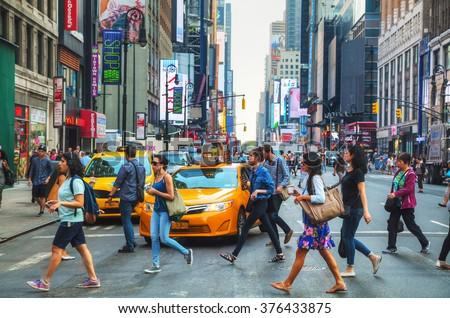 NEW YORK CITY - SEPTEMBER 4: People crossing a street on September 4, 2015 in New York.  - stock photo
