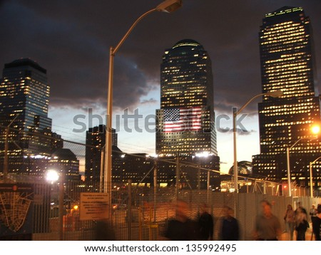 NEW YORK CITY - SEPTEMBER 11: people walk by Ground Zero in Manhattan on the 5th anniversary of the terrorist attacks on the World Trade Center, on September 11, 2006 in New York City, USA. - stock photo