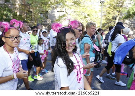 NEW YORK CITY - SEPTEMBER 7 2014: the annual Susan G Komen Race for the Cure filled the Upper West Side with several thousand pink-clad participants to raise awareness of breast cancer & raise funds - stock photo