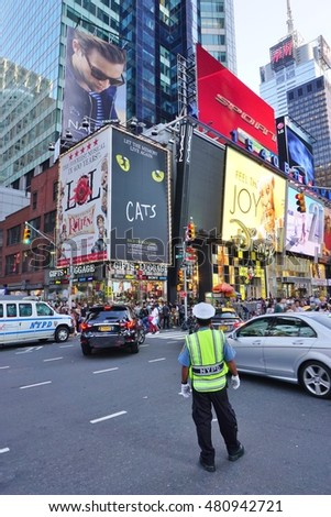 NEW YORK CITY -4 SEPTEMBER 2016- The busy Times Square at the intersection of Broadway and 7th Avenue in Manhattan with giant billboards and musical theaters.