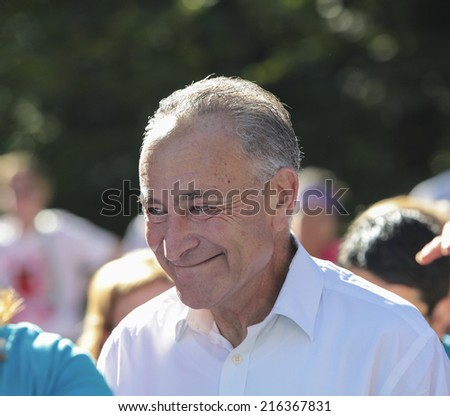 NEW YORK CITY - SEPTEMBER 7 2014: the Susan G Komen Race for the Cure took place along Central Park West with participants raising funds & awareness for breast cancer. US Senator Charles Schumer, - stock photo