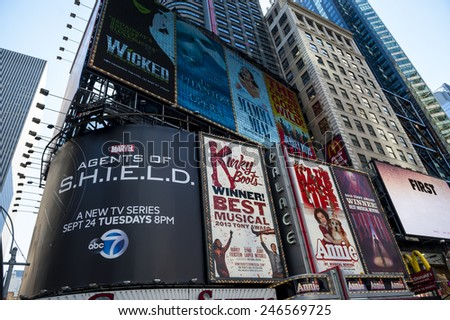 NEW YORK CITY - SEPTEMBER 18: Times Square, featured with Broadway Theaters and animated LED signs, is a symbol of New York City and the United States, September 18, 2013 in Manhattan, New York City. - stock photo